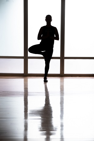 Silhouette of student doing yoga tree pose